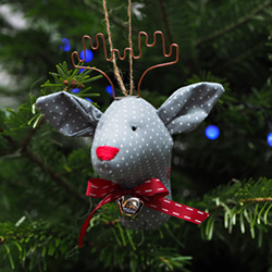 Hand-embroidered Christmas tree decoration - REINDEER WITH A BELL