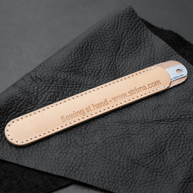 Ruler for stitch lenght measuring, stainless steel, in the leather case.